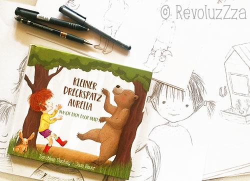 """Kinderbuch """"Kleiner Dreckspatz Aurelia"""" liegt auf Skizzen."""